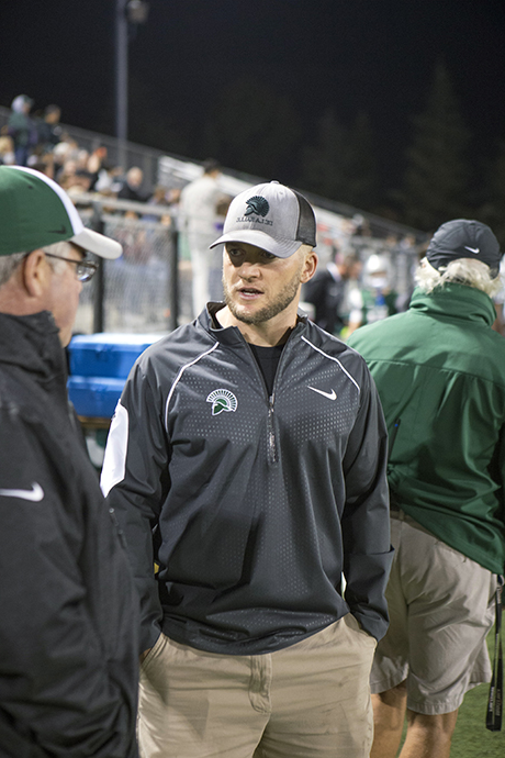 Mark Wine with coaches on the sidelines